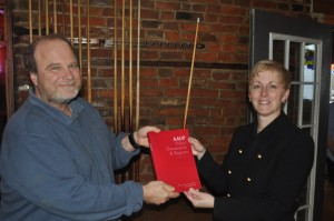 AAUP chapter president Marc Rice presents a copy of the AAUP Redbook to new provost Sue Thomas.